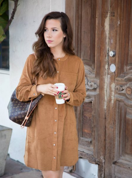 long-sleeved, brown mini suede dress with dark green leather handbag