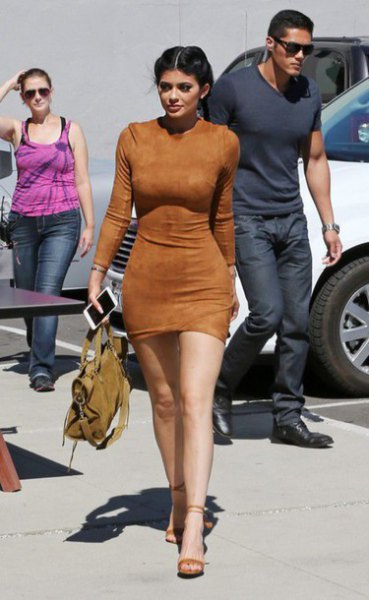 brown, form-fitting mini suede dress with open camel heels