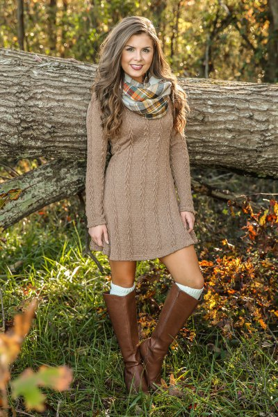 brown cable pattern mini dress with knee-high leather boots