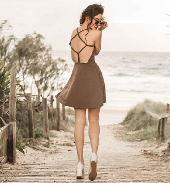 brown mini dress with open back and flared mini dress with white platform heels