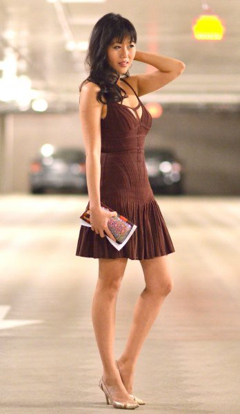 sleeveless fit and flare mini dress with deep v-neck and pink heels