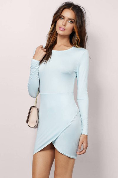 light blue, long-sleeved, figure-hugging wrap dress