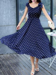 Dark blue maxi dress with a dotted fit and flared maxi dress with silver heels