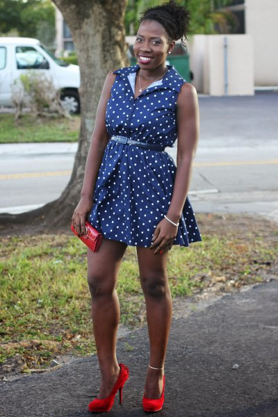 sleeveless mini dress with blue polka dot belt and red heels