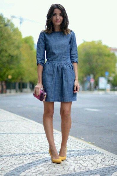 dark blue mini denim dress with gathered waist and mustard heel
