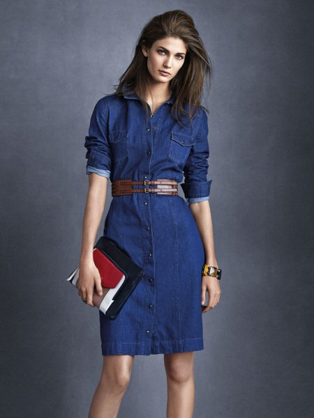 dark blue mini denim dress with belt and black and brown clutch