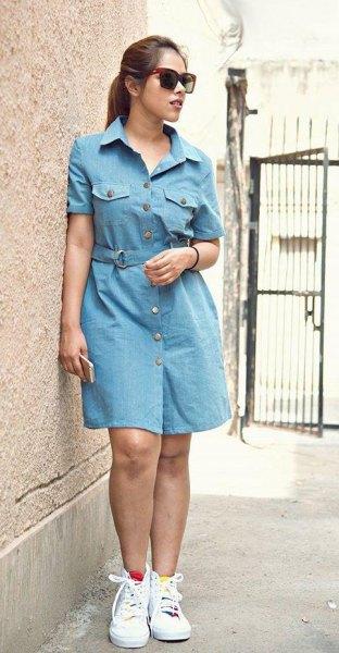 light blue denim mini dress with white sneakers