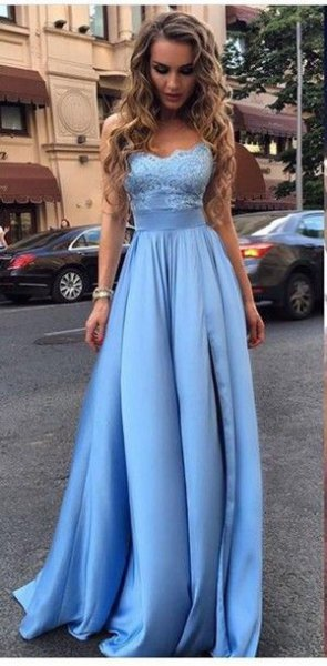 light blue fit and flared evening dress made of lace and silk