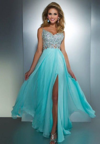 silver and light blue maxi dress with a high slit and metallic heels with open toes