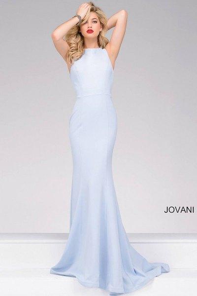 Light blue sleeveless mermaid maxi dress with white heels