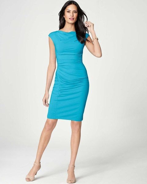 figure-hugging knee-length aqua blue dress with cap sleeves