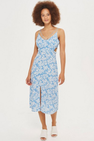 aqua and white midi dress with floral pattern and V-neck and white shoes with open toes