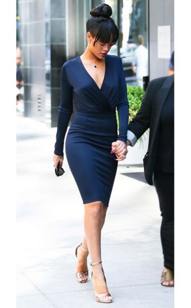 Midnight blue, form-fitting midi dress with a deep V-neck and silver heels