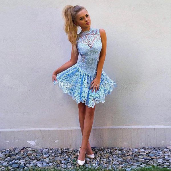 light blue sleeveless short skater dress made of lace with white heels