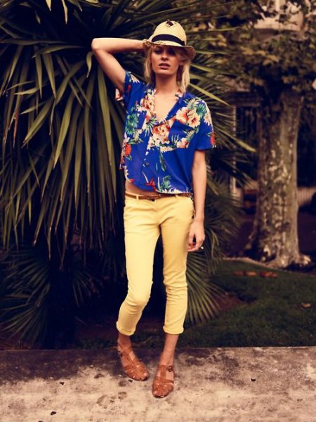 royal blue Aloha shirt with straw hat and yellow trousers
