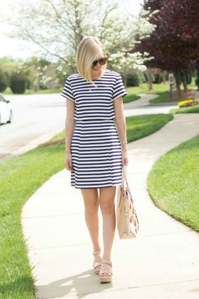 dark blue and white striped mini dress with light pink sandals