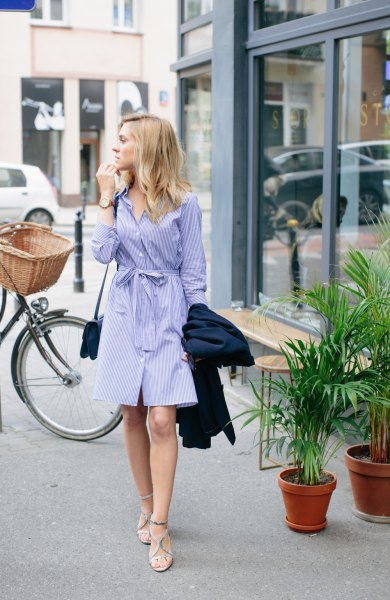 blue and white striped knee-length shirt dress with waist sand and strappy sandals