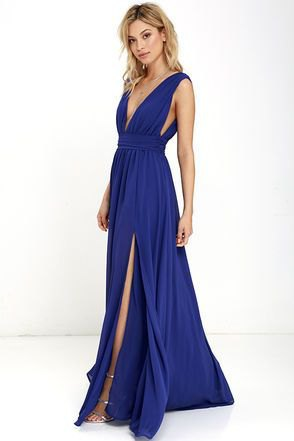 sleeveless, deeply slit dress with deep V-neck and flared dress