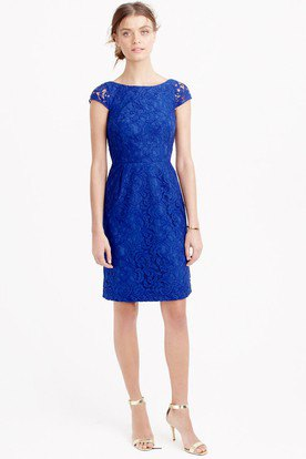 knee-length dress with cap sleeves in royal blue and gathered waist and silver heels