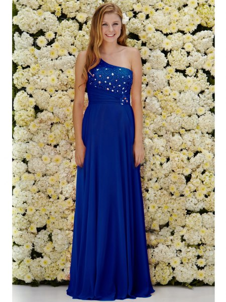 royal blue formal dress with one shoulder and white heels with open toes