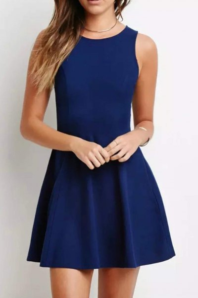 sleeveless dark blue mini cocktail dress with fit and flap