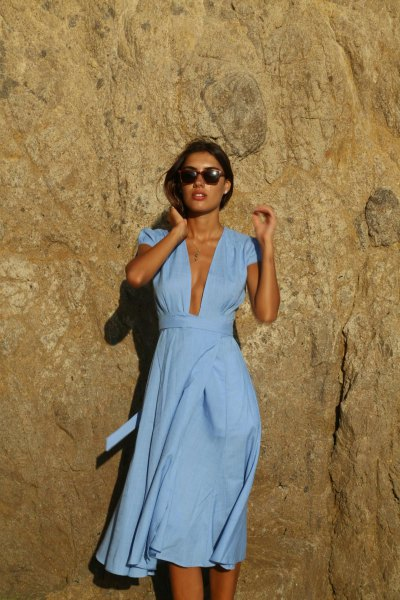 Light blue short-sleeved summer dress with a deep V-neck and midi wrap
