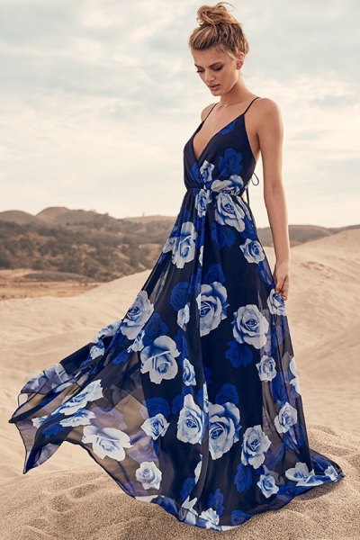 Dark blue, deep, flowing summer dress with a deep V-neck and floral print