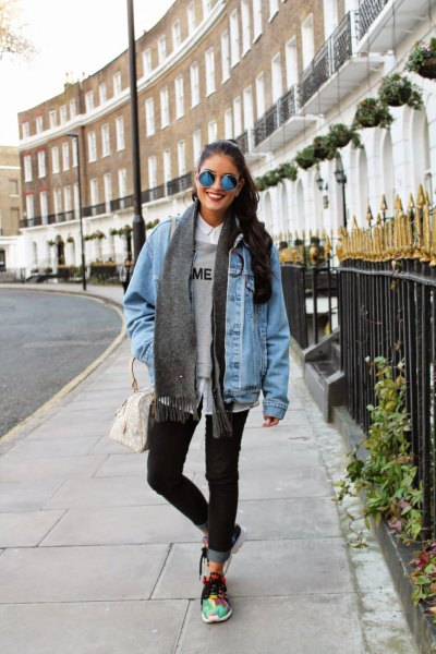 blue oversized denim motorcycle jacket with gray sweater