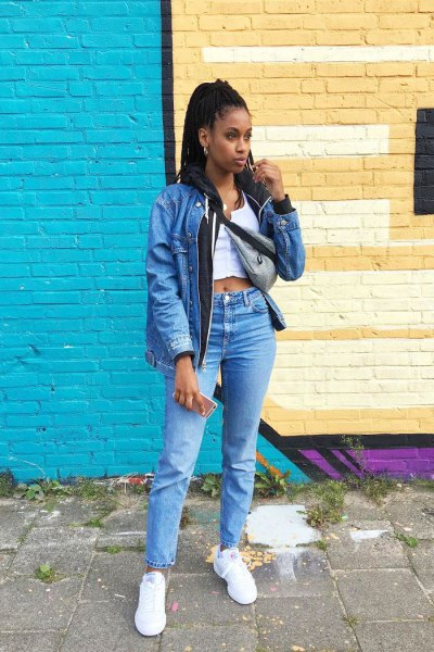 blue denim jacket with white, short vest top and high jeans