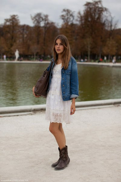 Boyfriend denim jacket with a white mini lace shift dress