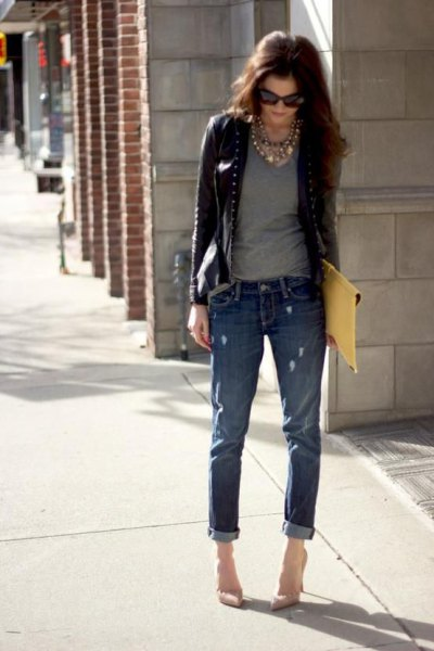 short leather jacket with gray t-shirt with a scoop neck and jeans with cuffs