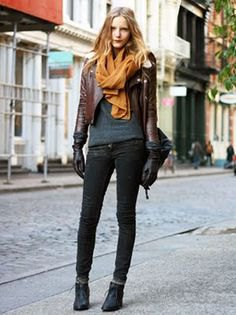 dark brown short leather jacket with gray knitted sweater
