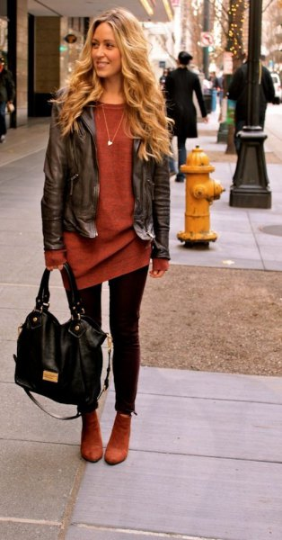 black short leather jacket with red tunic sweater