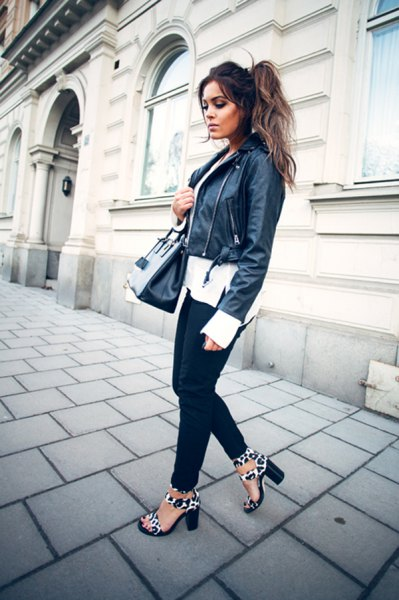 black moto jacket with white chiffon blouse with a relaxed fit