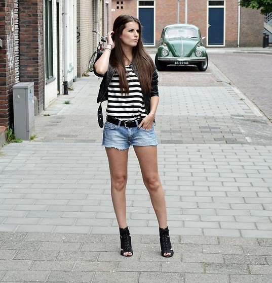 black and white striped t-shirt with short leather jacket and denim shorts