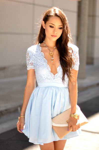 Light blue fit & flare mini dress with deep v-neck and blushing clutch
