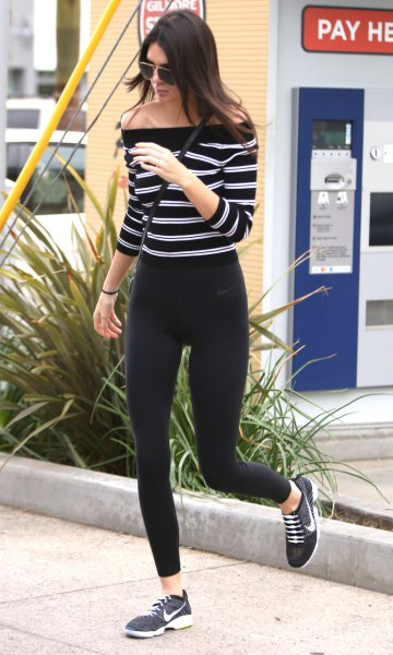 black and white horizontally striped shoulder sweater with windbreaker tights