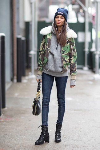 Camouflage windbreaker with faux fur collar, gray hoodie and dark blue skinny jeans
