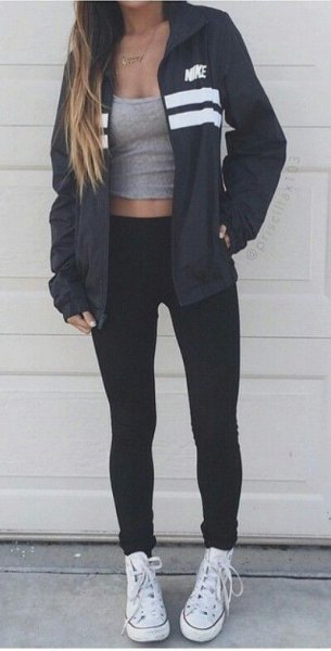 black oversized windbreaker with a gray, short-cut tank top