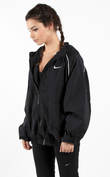 black oversized windbreaker with matching slim fit nylon pants
