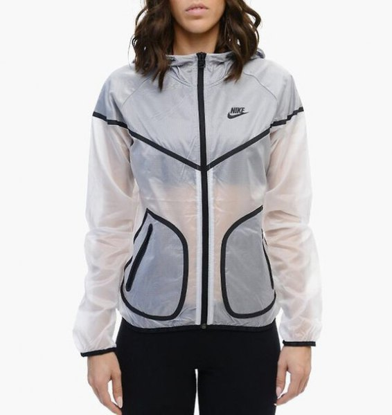 semi-transparent white Nike windbreaker with black running pants