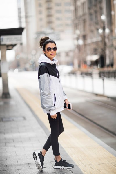 white and gray oversized windbreaker with running pants