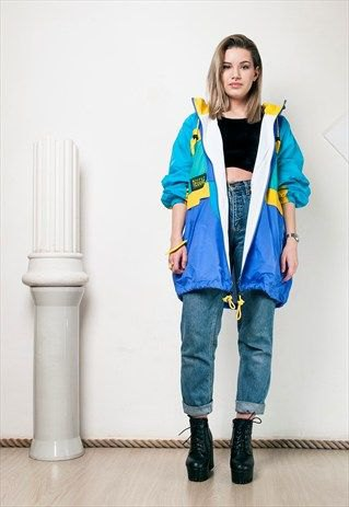 blue-pink and yellow windbreaker with black crop top and high-rise jeans