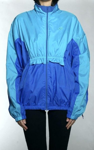 royal blue and teal windbreaker with black skinny jeans