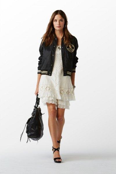 black polo windbreaker with white mini dress
