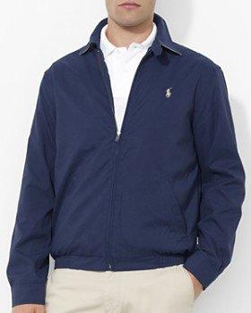 dark blue windbreaker with white polo shirt