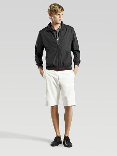 black windbreaker with white knee-length shorts