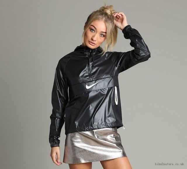 shiny black windbreaker with silver mini skirt