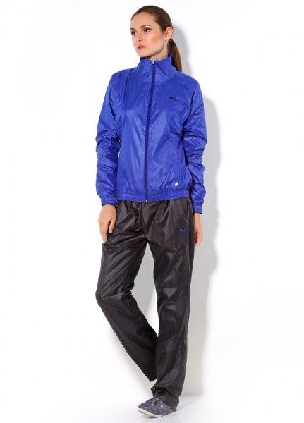 shiny blue windbreaker with black nylon pants