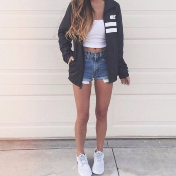 black oversized windbreaker with white crop top and blue denim shorts